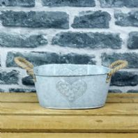 A Rustic Metal Planter With Heart Detail...24.5 x 10.5 x 14.5cm...